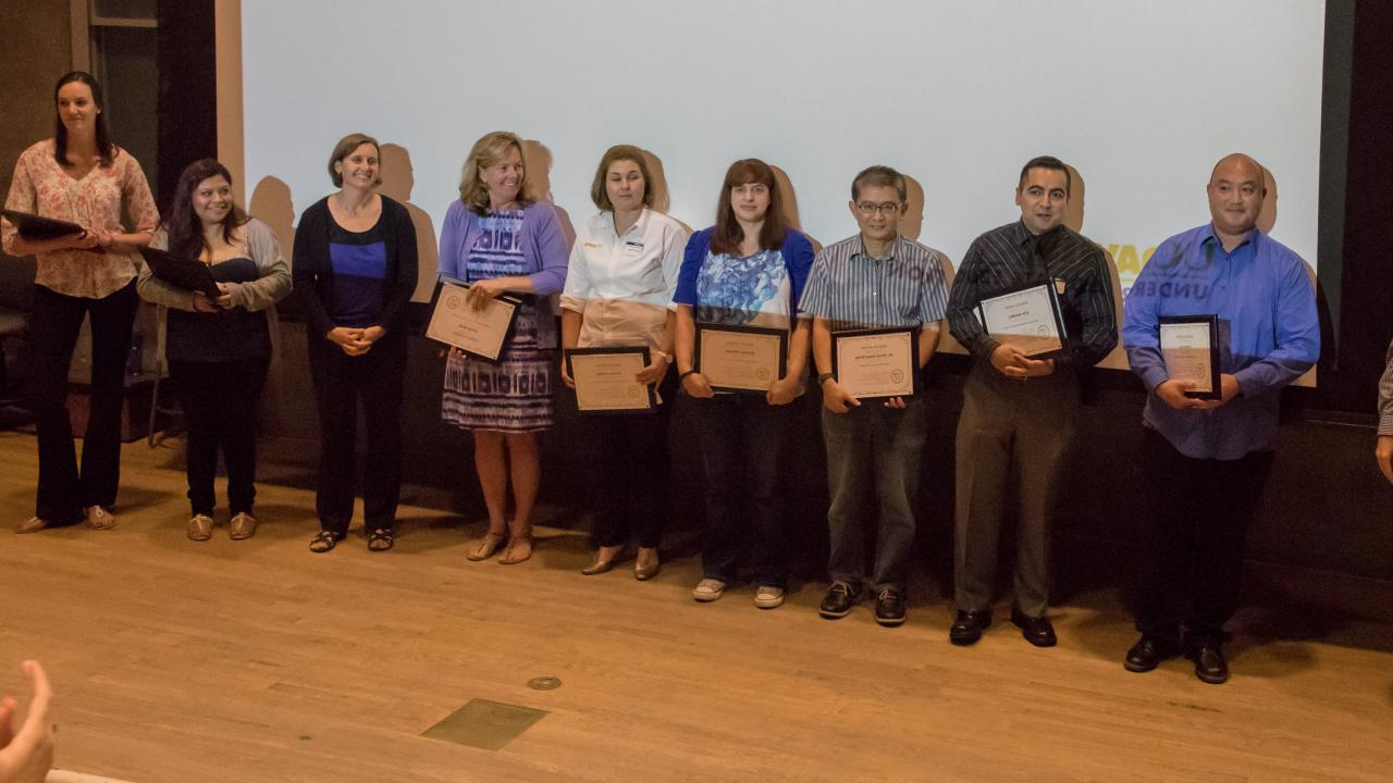 2015 recipients pictured holding awards.