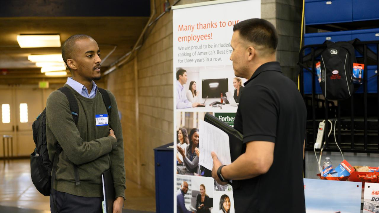 Student at Career Fair speaking with rep.