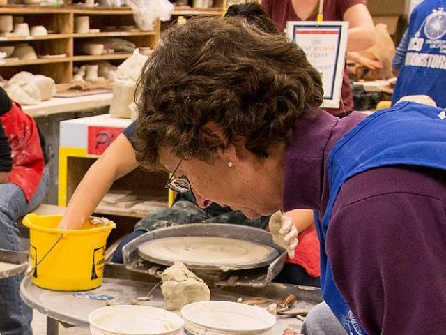 Students working on clay work at Craft Center.