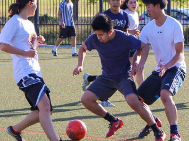 Students playing soccer.